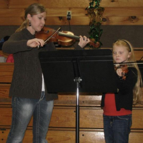 Performing on violin at an event with one of my students.