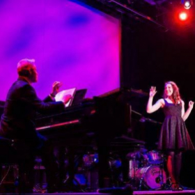 Emily Performing in a fundraiser gala for performing arts.
