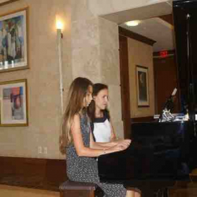 During Annual Recital, playing piano duet with a student.