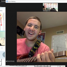 Teaching Jake barre chords through Zoom