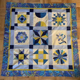 Advanced quilting student, online lessons. Sampler quilt in progress.