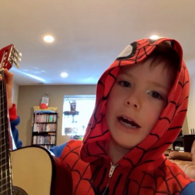 Jaxen likes to dress up for his online guitar lessons.