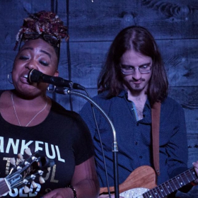 On stage with Annika Chambers during a blues jam at the North Atlantic Blues Festival.