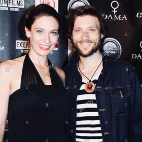 Thomas at a red-carpet film premiere in Los Angeles with his wife, actress Danielle Adisi.