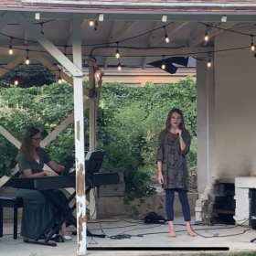 """Student performing """"Country Roads"""" by John Denver at our August 2020 outdoor concert."""