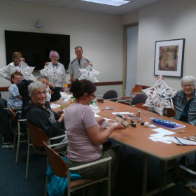 This is a group class.  Each student is making a giant snowflake.  This class was held at Widener University.
