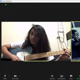 Ambiya performing a song out of a method book