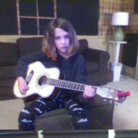 """Emmie getting warmed up to perform """"Radioactive"""" by Imagine Dragons"""