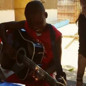 Teaching kids in Africa to play the guitar