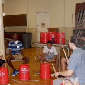 Teaching a bucket drumming class at the Rock to the Future Summer Music Camp in Philadelphia
