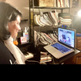 Teaching an online piano lesson with a young student who loves to sing and play at the piano!
