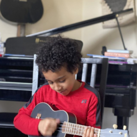 This kid loves to play his Uke