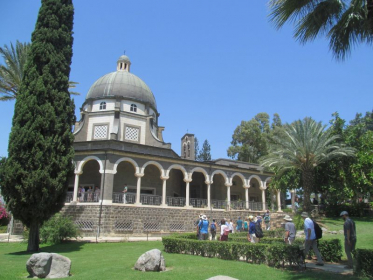 The church of the beatitudes next to the sea of Galilee.