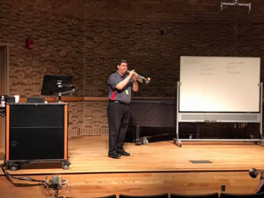 Teaching a masterclass to high school and college students.