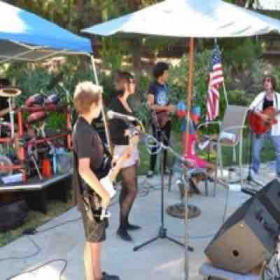Rocking out at a pool party with my rock band 101 class