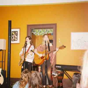 Playing a house show with my band mate!