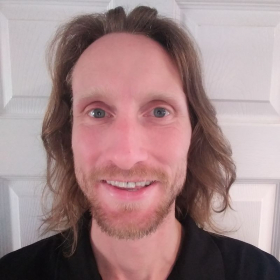 A too close smile for the camera tutor profile pic during the '20 Covid Lockdown