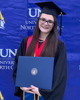 Graduation, Summa Cum Laude: Honors double major in English & Interdisciplinary Studies, with a focus on linguistics and cognitive science.