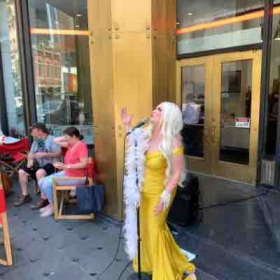 Vocal Coach Katie performing in downtown Dallas