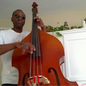 Proper hand position on the double bass is critical. left elbow should be position at an 45 degree angle, allows evenness of playing .