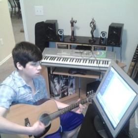 Student Learning with Guitar Pro Strumming Techniques