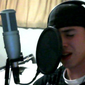 Recording vocals for my band.