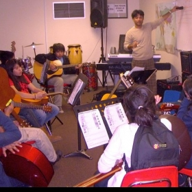 Group guitar and music theory class at A Place Called Home