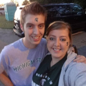 My sister and I, tailgating at Michigan State University. GO GREEN!