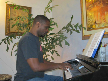 Marvin loves his Piano lessons, reading music and improvising
