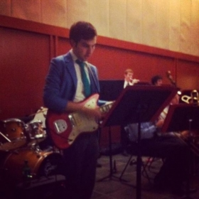 Playing electric guitar with the Trinity University Jazz Band