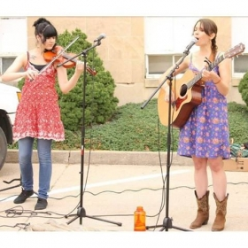 Woman on the right, Is a vocal student who has four CD's and is presently touring the U.S.