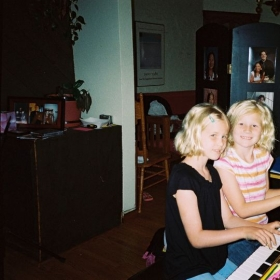 A piano duet by sisters