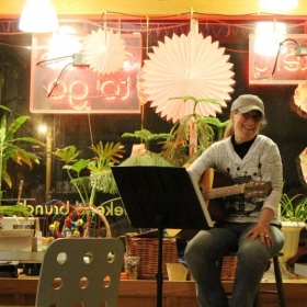 Me performing at the Buttery Bakery Cafe.