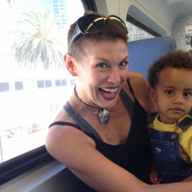 Danielle, post-news that she is cancer-free ;)!, on a train ride with son, Lucian. ;)