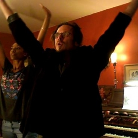 Teaching a voice student powerful breathing warm-ups in my home studio in NOHO Arts District.