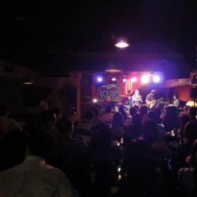 Performing at Riverside Cafe with 100+ audiences