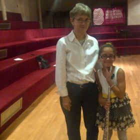 With a student, post performance at the Third St. Music School Settlement.