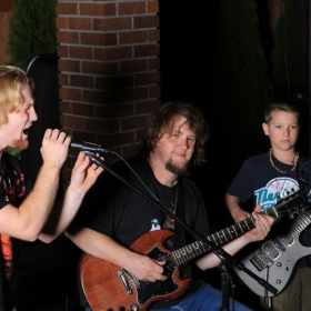 Chris hosting an all-ages open mic night for students at Sparks Firehouse Deli