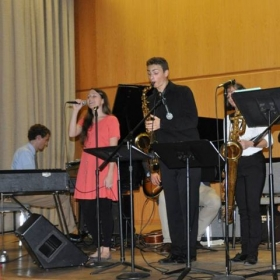 Performing on baritone saxophone in a student recital at Temple University.