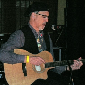 Jeff, performing solo at a music festival in Harrisburg, PA