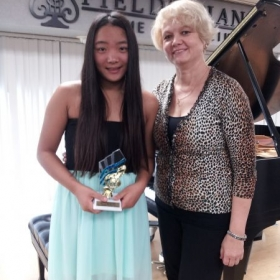 Yuki is 13 years old. She is 5th level. She has award for her play on the Recital  in 2013 year.