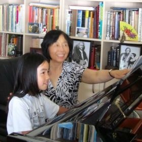 Megan L and Xiaole L enjoyed music in piano lesson.