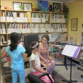Two sisters at the studio, learning flute