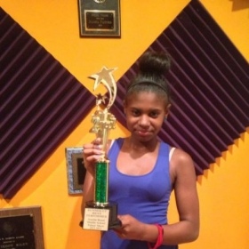Jaline won best vocalist in a talent show. KR Music Studio had her prepared and she came in first place