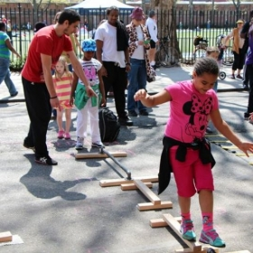 Jesse teaching children how to balance StreetGames, hosted by NYC Parks & Rec