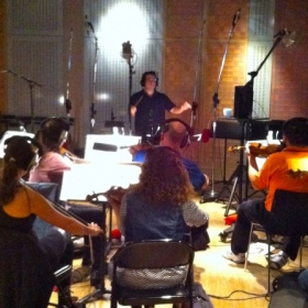Nicolas conducting a string orchestra for his film score to Ode In Blood in Pasadena, CA.