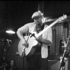 Performing on acoustic bass guitar at Toad in Cambridge, MA with Brian Carroll.