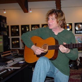 Ralph in a studio recording guitars for A Bad Think.