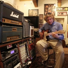 Ralph in a studio working on guitar parts.