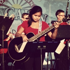 Playing bass guitar at a gig with Downbeat Big Band in El Cajon, CA in 2013.